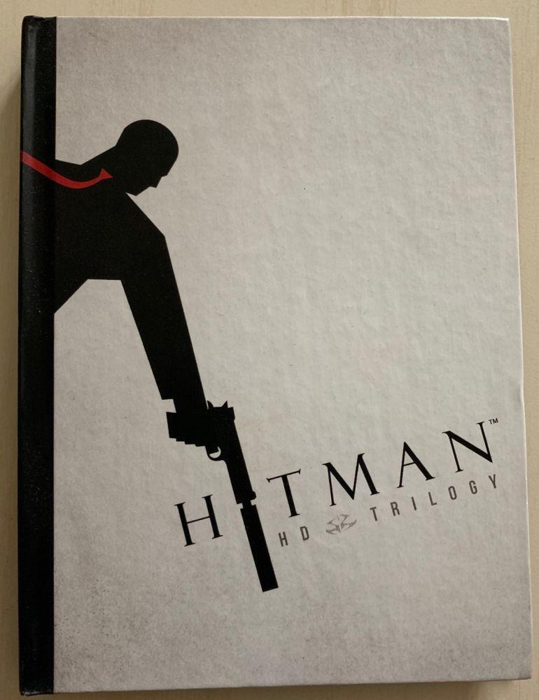 Hitman HD Trilogy + kniha PS3